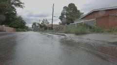 Water After Rainstorm Running Down Street Reverse Stock Footage