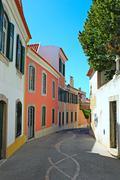 A narrow street in Lisbon, Portugal - stock photo
