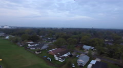 Neighborhood over to river and bridge, Baton Rouge, LA, Aerial - stock footage