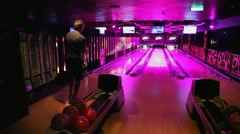 Bowling game at the night disco club and restaurant - stock footage