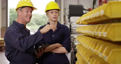 Two co-workers managing a warehouse. Shot on RED Epic Stock Footage