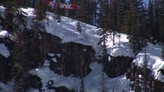 Skier crashes off cliff Stock Footage