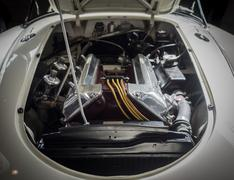 View of the engine of a white classic sports car. Stock Photos