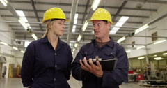 Two co-workers managing a warehouse. Shot on RED Epic - stock footage