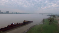 Freighter along shoreline, skyline in distance over river, Baton Rouge, LA, Stock Footage