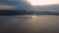 Hazy sunrise over skyline across the Mississippi River, sunbeams, Baton Rouge, Stock Footage