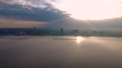 Sunrise over city skyline across the Mississippi River, Baton Rouge, LA, Aerial Stock Footage