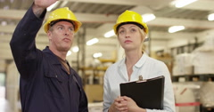 Argumentative warehouse manager talks to his boss. Shot on RED Epic Stock Footage