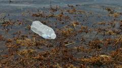 Plastic bottle floating in water Stock Footage