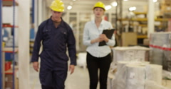 Portrait of two coworkers going through the orders in a warehouse. Stock Footage