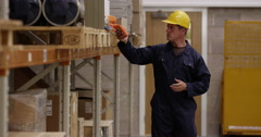 Warehouse manager inspecting stock levels in a manufacturing plant. Stock Footage