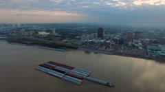 Sunrise over skyline across the river barges, Baton Rouge, LA, Aerial Stock Footage