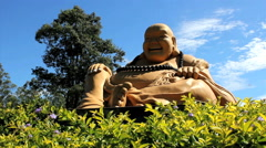 Buddhism temple - Traditional architecture and sculptures. Hotei, buddha Stock Footage