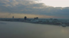 Sunrise over city skyline from across the Miss. River, Baton Rouge, LA, Aerial - stock footage
