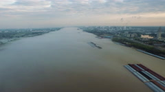 Mississippi River, land on both sides, barge in water, Baton Rouge, LA, Aerial - stock footage