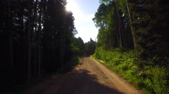 Driving down an old Colorado country road into the setting sun. Stock Footage