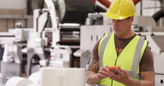 Warehouse manager in a large production facility. Stock Footage