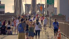 Crowd Brooklyn Bridge people pedestrians walking crowded New York City NYC Stock Footage