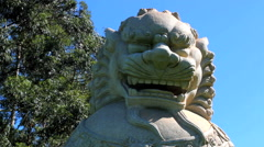 Buddhism temple. Traditional Koma-inu sculpture.  - stock footage