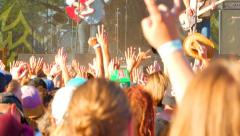 4K Dancing Crowd Live Music Festival. Women Jumping in Front of Stage Stock Footage