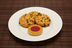 A plate of cookies on dark brown background Stock Photos