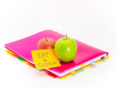 Office Documents and Apples; Eat and Sleep - stock photo