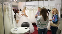 A young woman tries on a wedding dress Bridal salon. Stock Footage