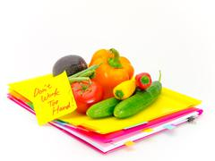 Office Documents and Vegetables; Don't Work Too Hard - stock photo