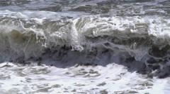The big waves break against the rocks Stock Footage