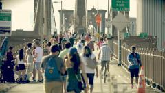 Crowd traffic Brooklyn Bridge people walking pedestrians bicycles New York City - stock footage