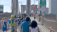 Crowd Brooklyn Bridge people pedestrians walking crowded New York City NYC day - stock footage