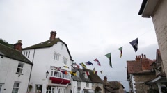Traditional English Coastline houses with Regatta flags, England, Europe - stock footage