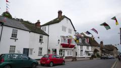 English Medieval Fishermans village with Regatta flags, Beer, England Stock Footage