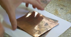 Man's Hands Are Polishing The Copper Plate Holding the Plates Stock Footage