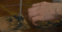 Man's Hands in Gloves Are Washing The Copper Plates in Water under the Water Stock Footage