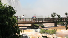 Tourists on the viewpoint in front of the Iguazu Waterfall. Brazil - stock footage