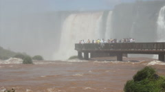 Time lapse - Tourists on the viewpoint in front of the Iguazu Waterfall. Brazil - stock footage