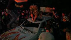 The riots in the city, fire. People break the car Stock Footage
