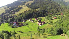 Village at  Ukrainian Carpathians mountains and nature. Aerial  Stock Footage