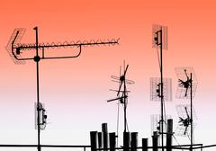 antennas and pipes on the roof - stock photo