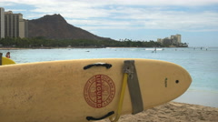 Lifeguard surfboard and diamond head Stock Footage
