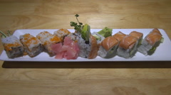 Tray of delicious sushi with salmon and flying fish roe is on the table Stock Footage