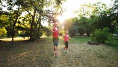 Mother and daughter jogging Stock Footage