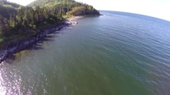 Aerial view along wild coast in Haute Gaspesie Stock Footage