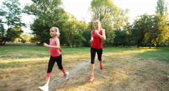 Athlete family mother jogging against the sunlight Stock Footage