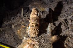 Image of the cave with stalagmites - stock photo