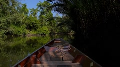Fisherman Fishing in Amazon Jungle River on Wooden Boat Stock Footage