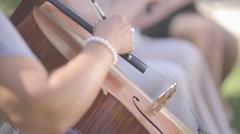 Woman playing on a cello (flat ungraded) Stock Footage