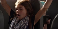 Young girl tired and cranky on bus - stock footage