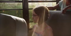 Young girl fighting off a bully in school bus - stock footage
